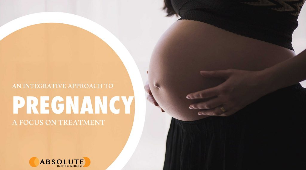 pregnant woman with hands on her stomach with a text bubble saying an integrative approach to pregnancy